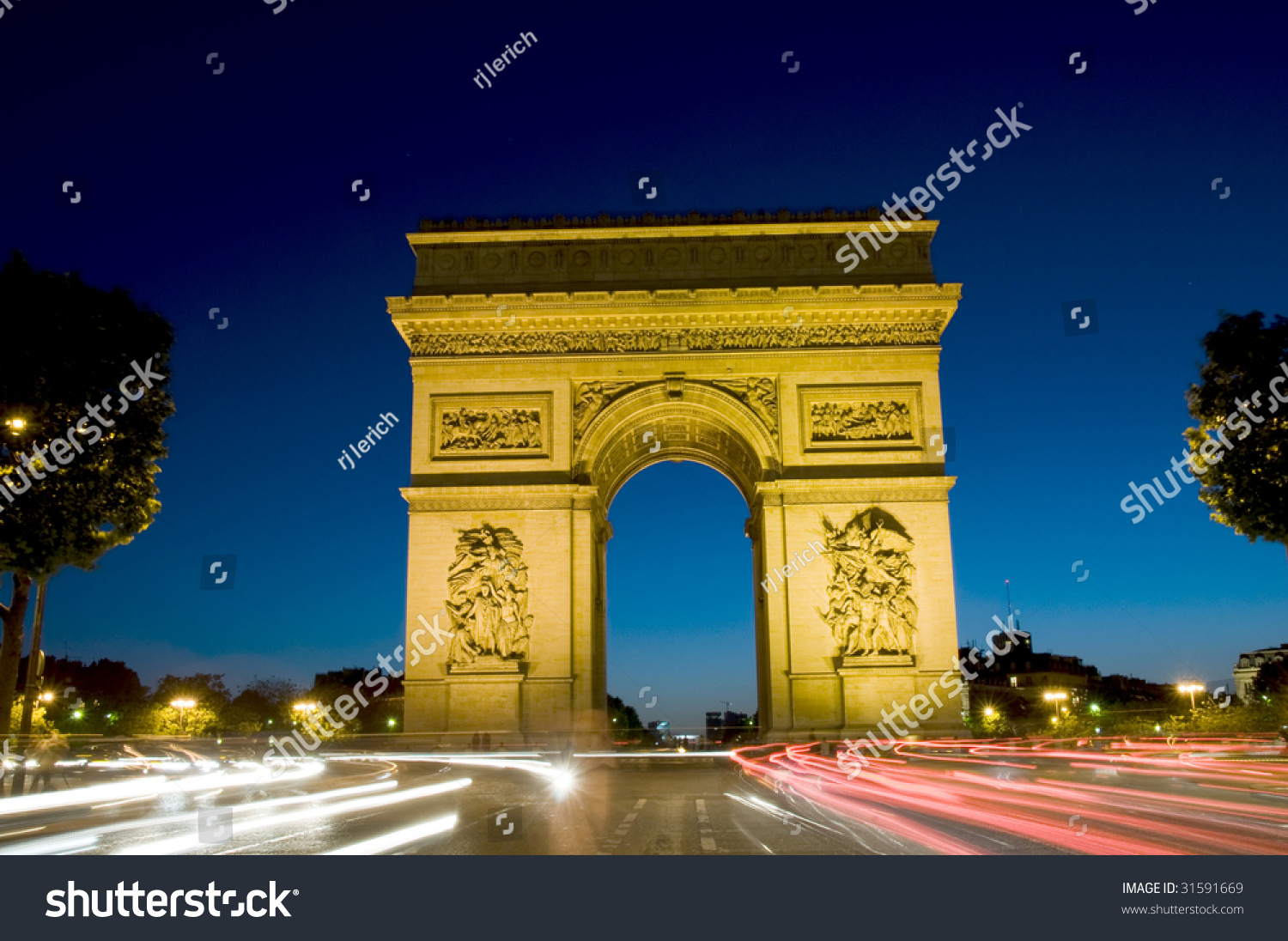 arc de triomphe arch of triumph at night with car streaks in the center of the place charles de. Black Bedroom Furniture Sets. Home Design Ideas