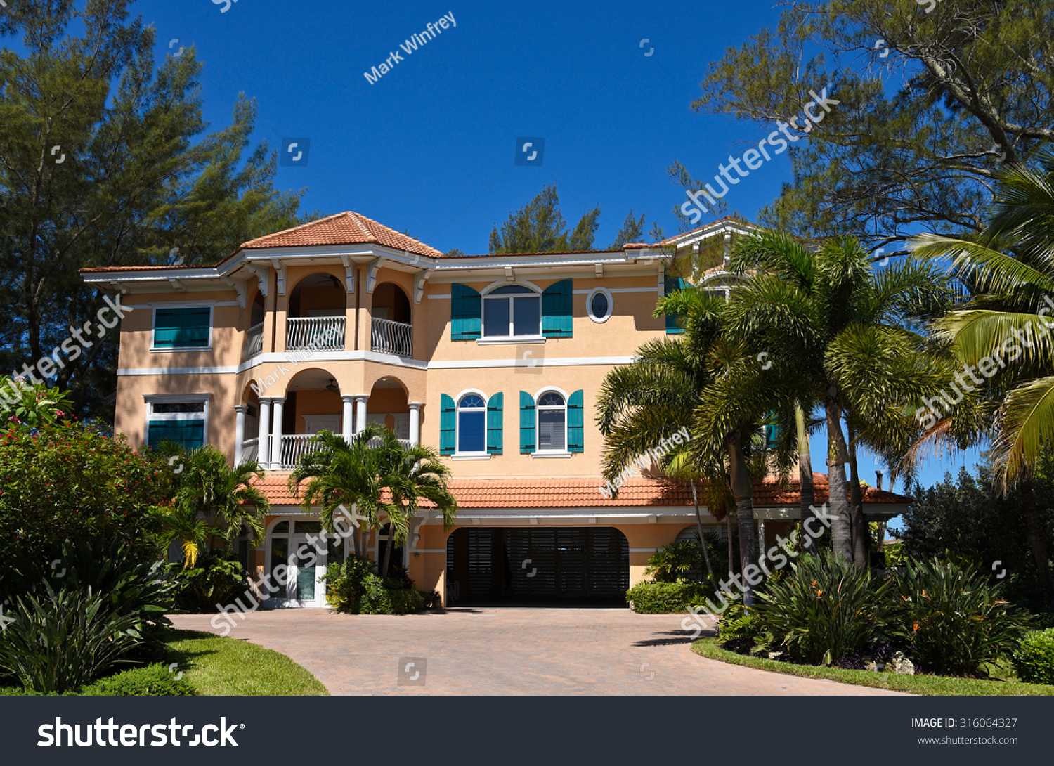 Large beach house beautiful landscaping on stock photo for Large beach house