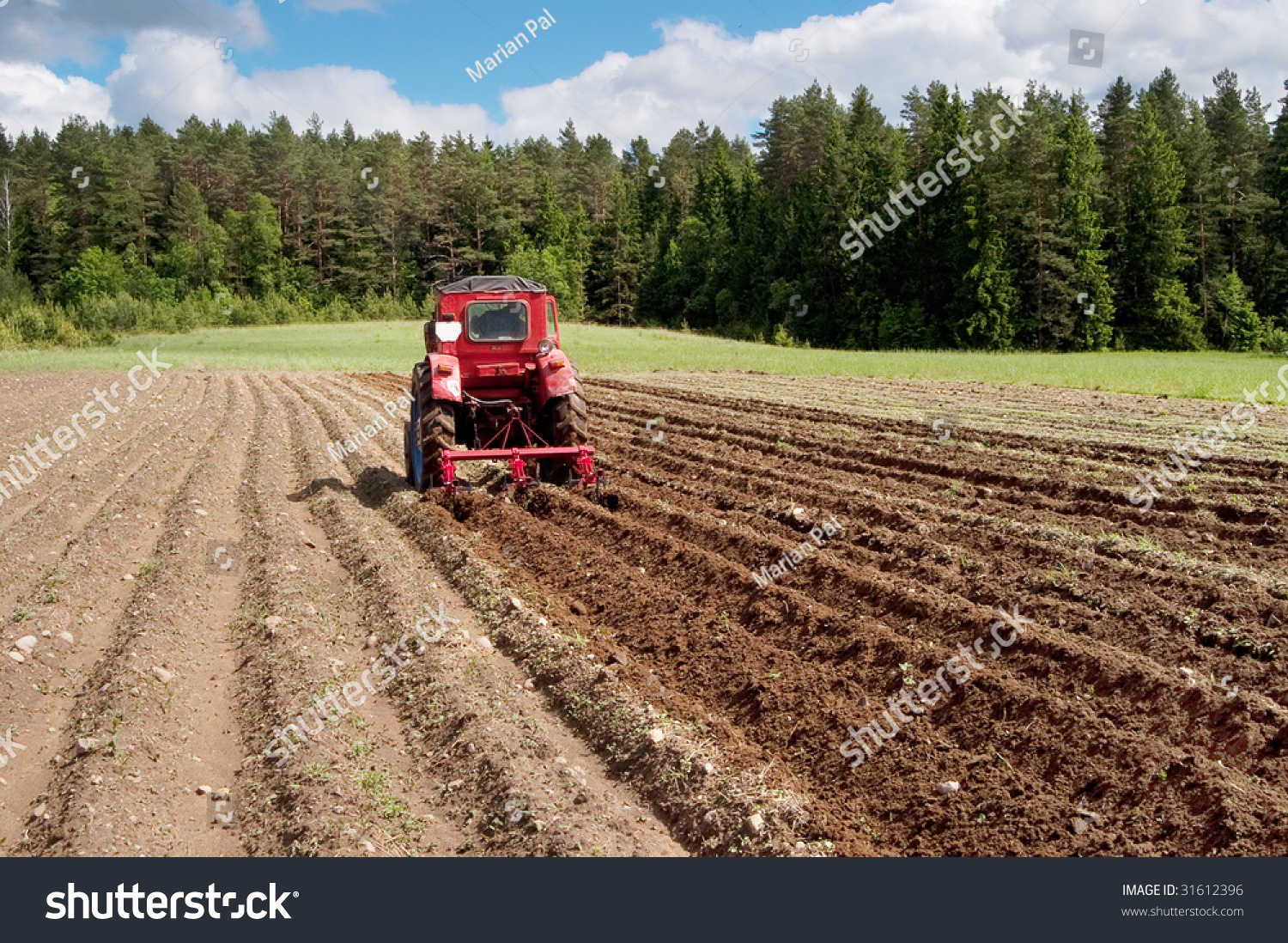 Tractor In Field Planting : Tractor on field preparing soil planting stock photo