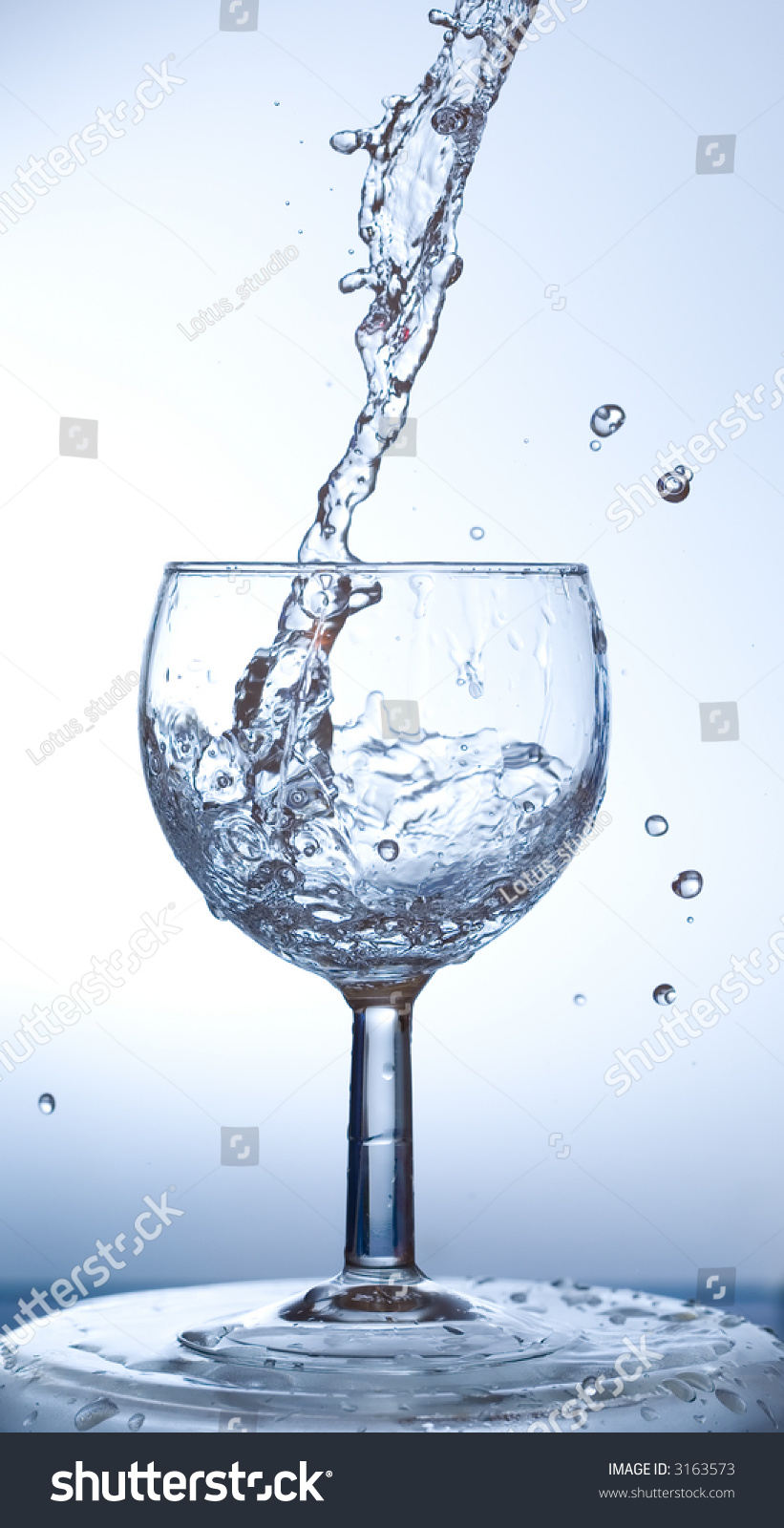 Water Being Poured Into Wine Glass Stock Photo Edit Now