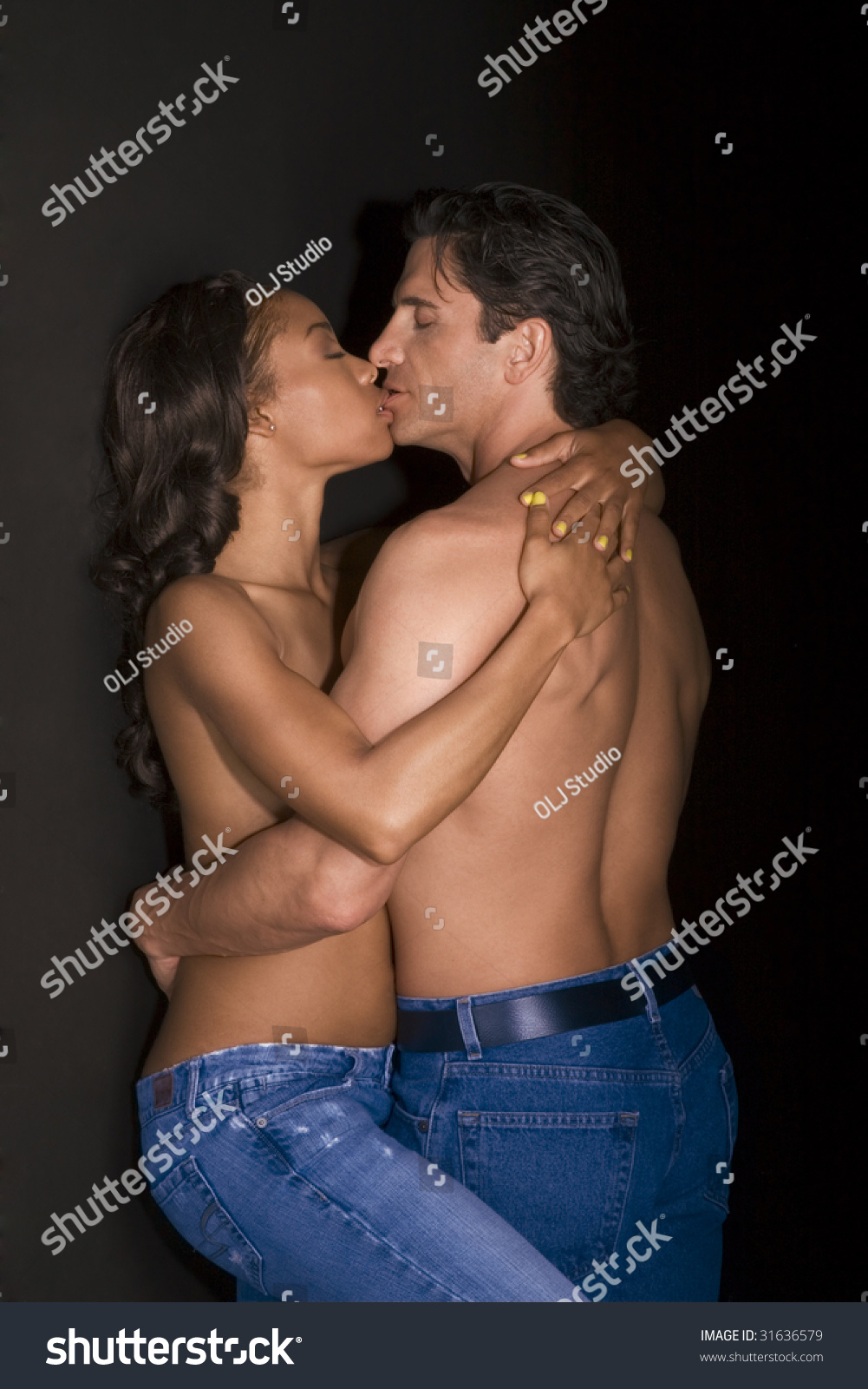 loving affectionate nude interracial heterosexual couple stock photo