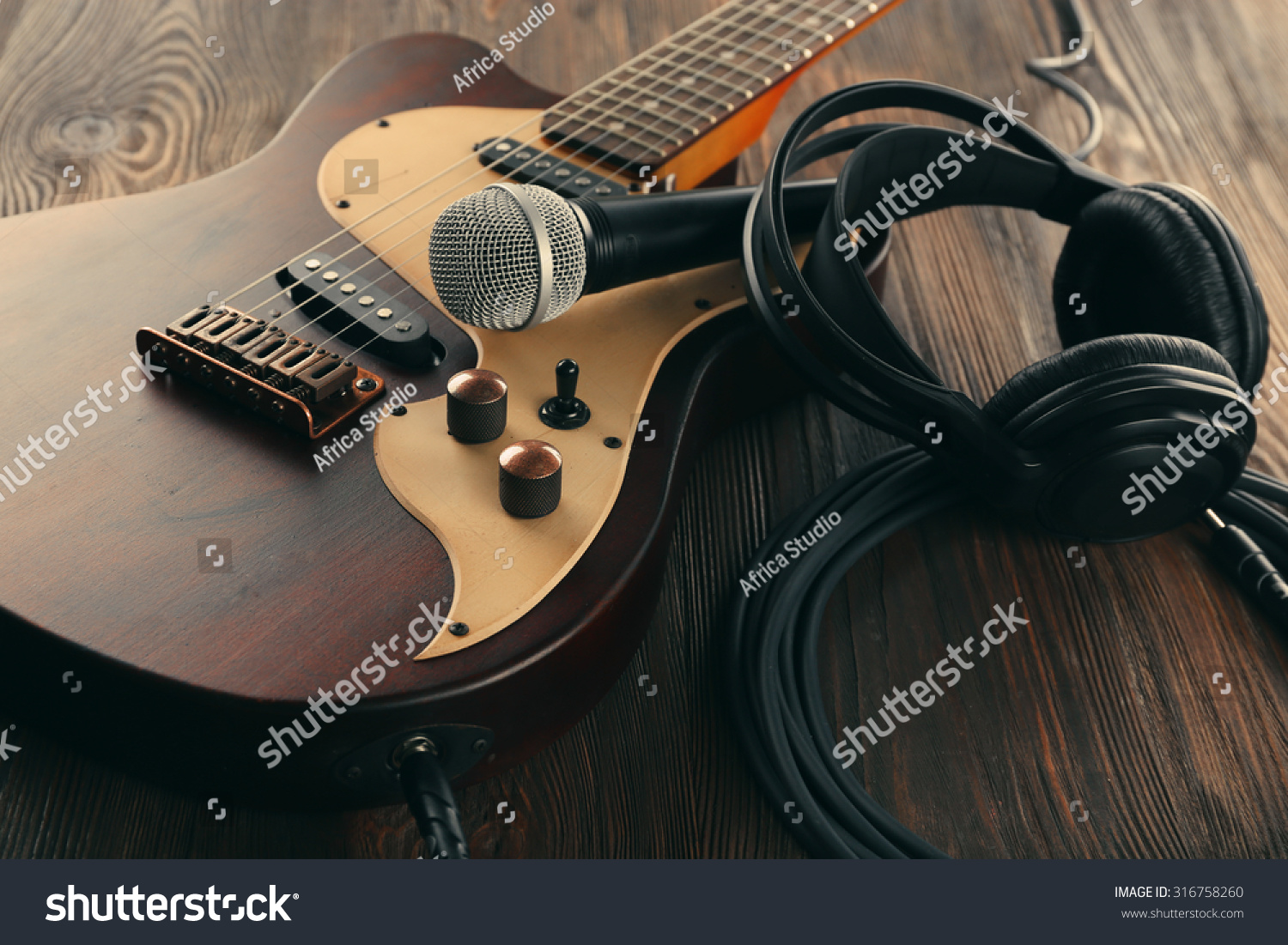 electric guitar with microphone and headphones on wooden table close up stock photo 316758260. Black Bedroom Furniture Sets. Home Design Ideas