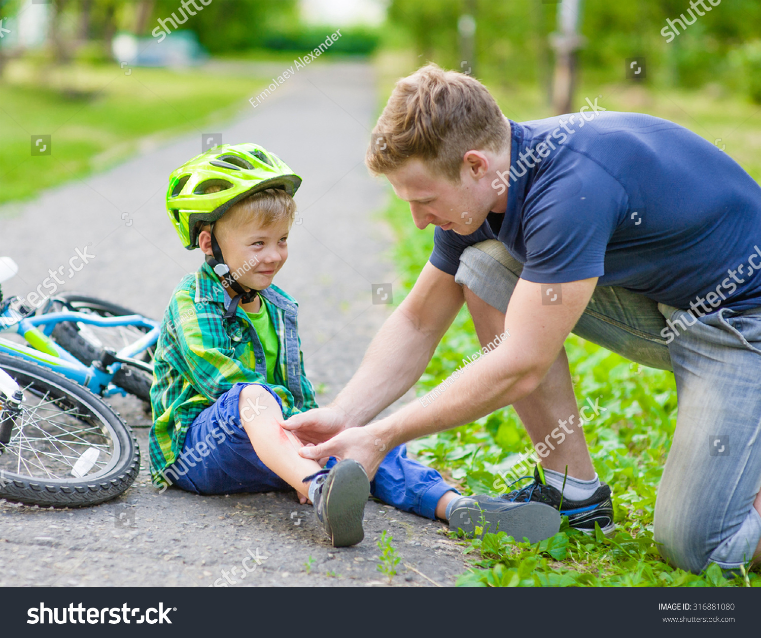 Father Putting Bandaid On Young Boys Stock Photo 316881080 ...