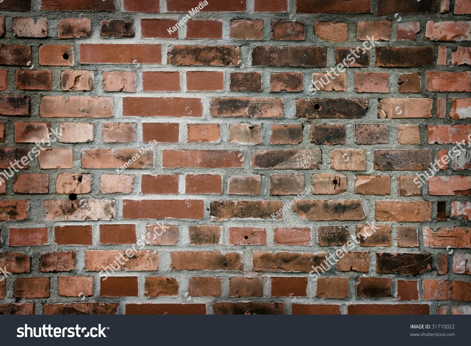 Bullet holes in brick wall
