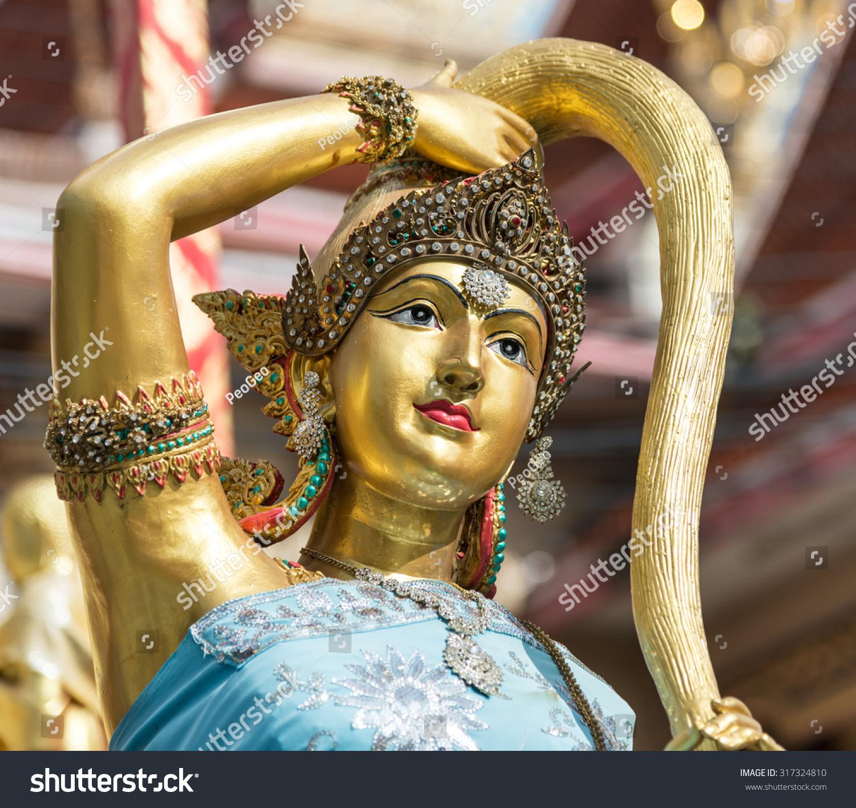 Ancient Gaia Statue earth goddess bronze statue closeup on stock photo (edit now