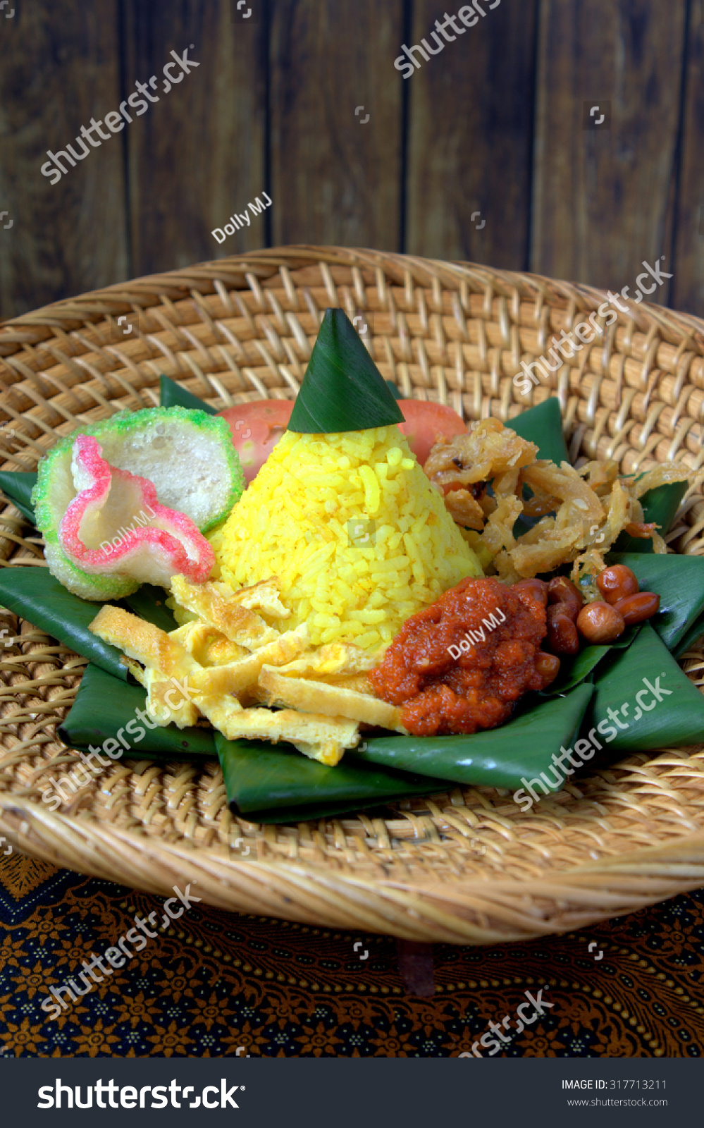 Royalty Free Nasi Kuning Or Kunyit Popular 317713211 Stock Indonesian Cuisine With Coconut Milk And Turmeric The Rice Looks Like A Pile Of Gold Often Served At Parties