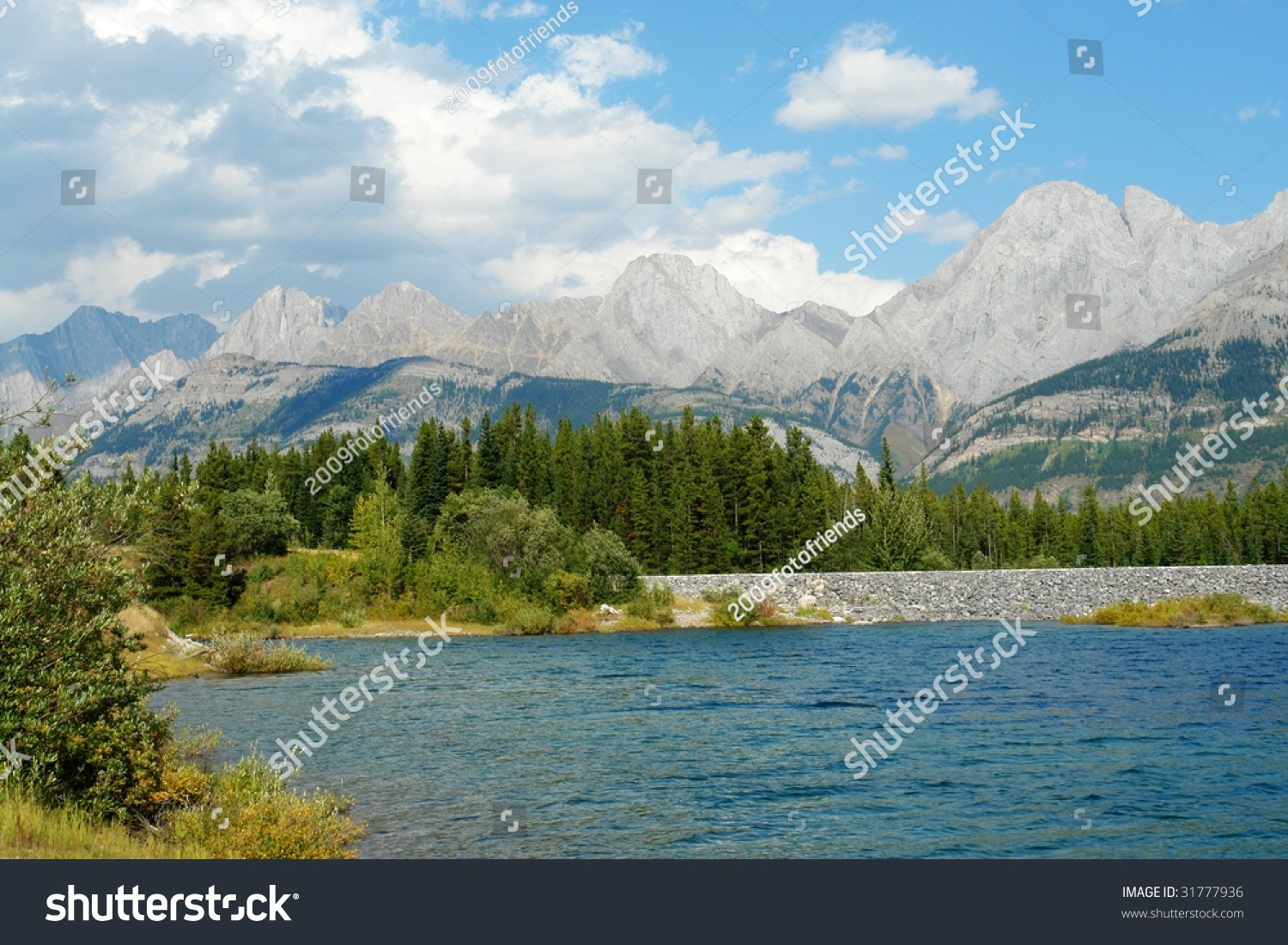 Summer View Of Rocky Mountains And Lake In Lights Shadows Kananaskis Country Alberta