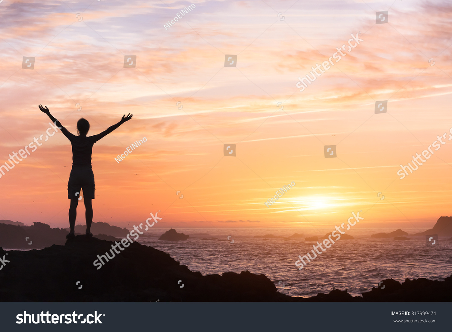 Silhouette Of Young Woman With Open Arms Facing The Sea At ...