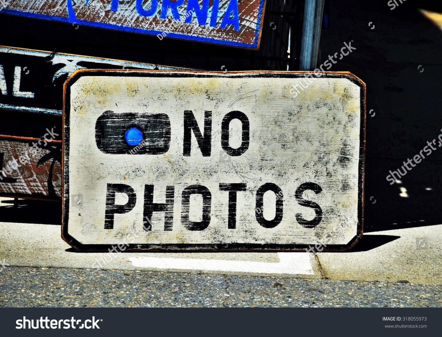 Some street vendors along the Venice Beach Boardwalk in southern California post NO PHOTOS signs, prohibiting photography of their wares.