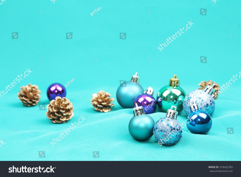 blue christmas tree ornaments on blue background - Blue Christmas Tree Ornaments