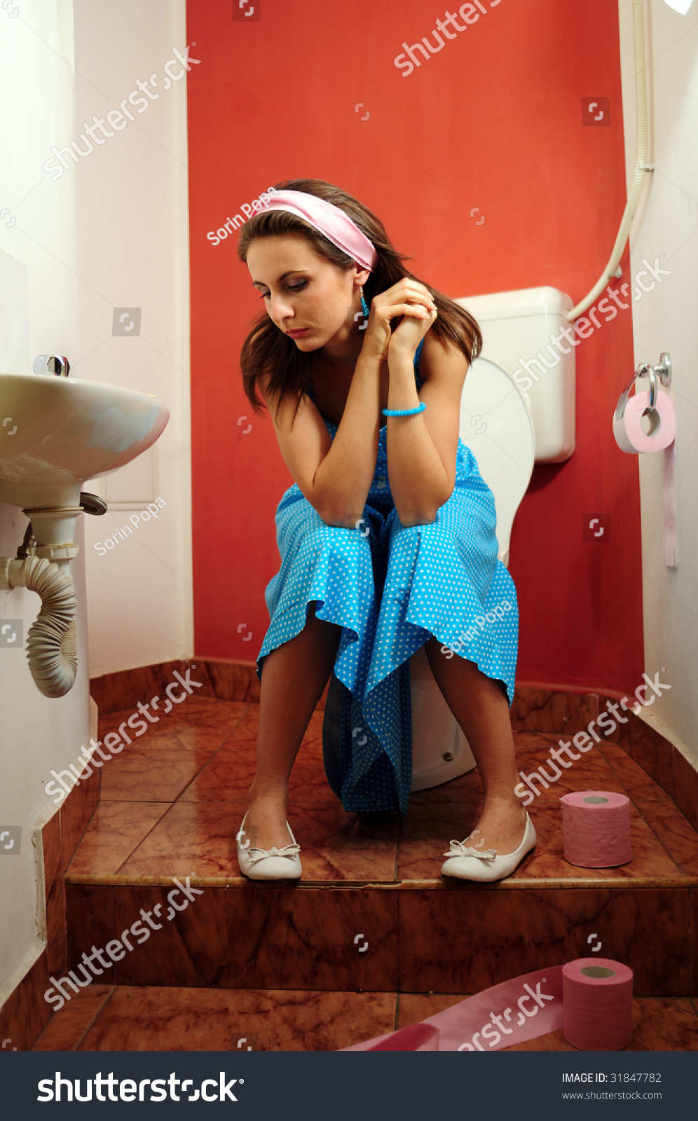 woman sitting on the toilet, Stock Photo, Picture And