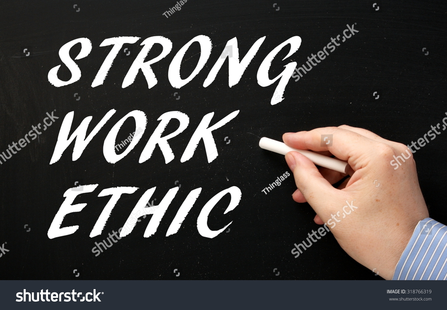 hand writing phrase strong work ethic stock photo 318766319 hand writing the phrase strong work ethic in white text on a blackboard as a reminder