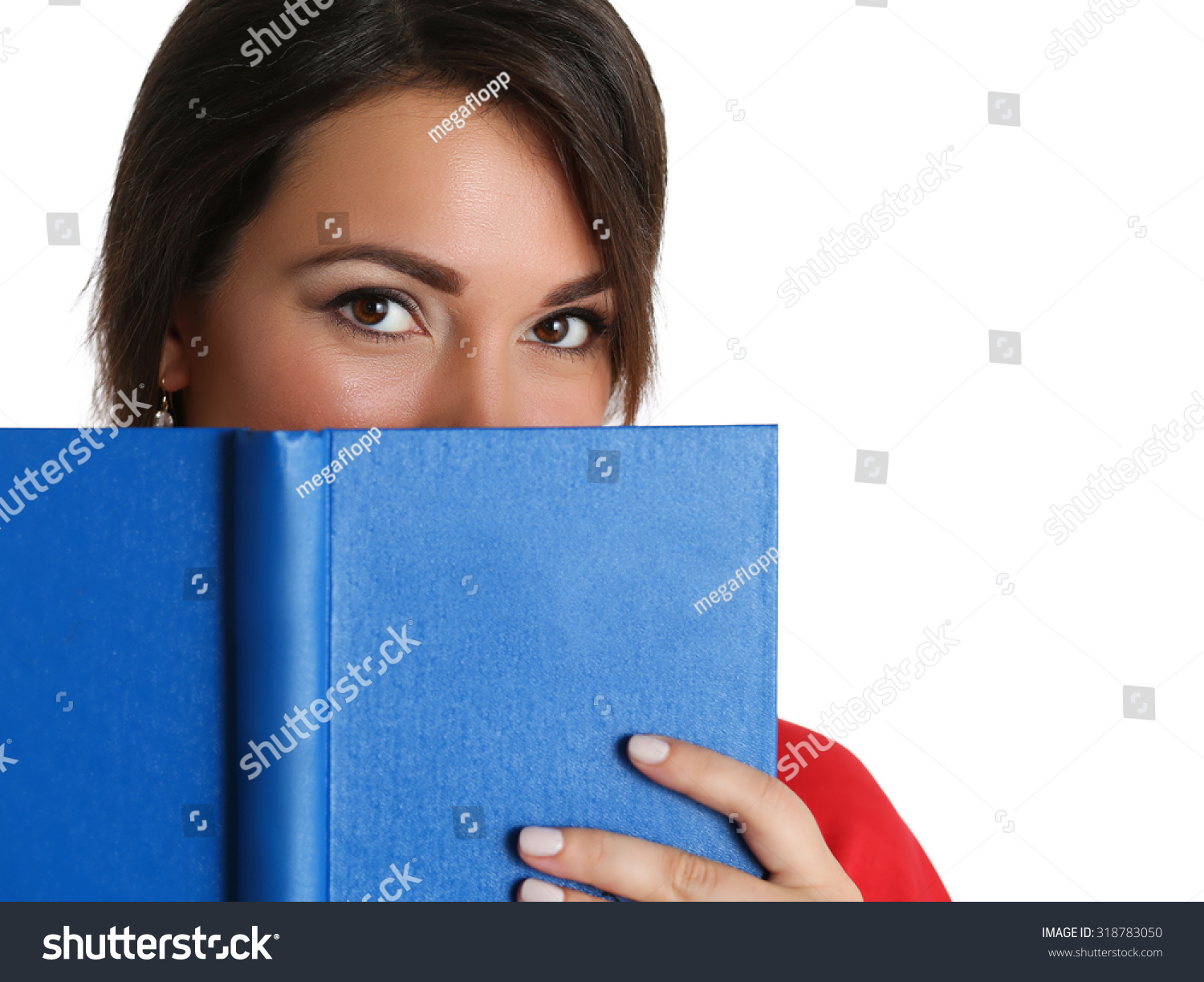 Book Covering Face : Beautiful brunette woman red dress covering stock photo