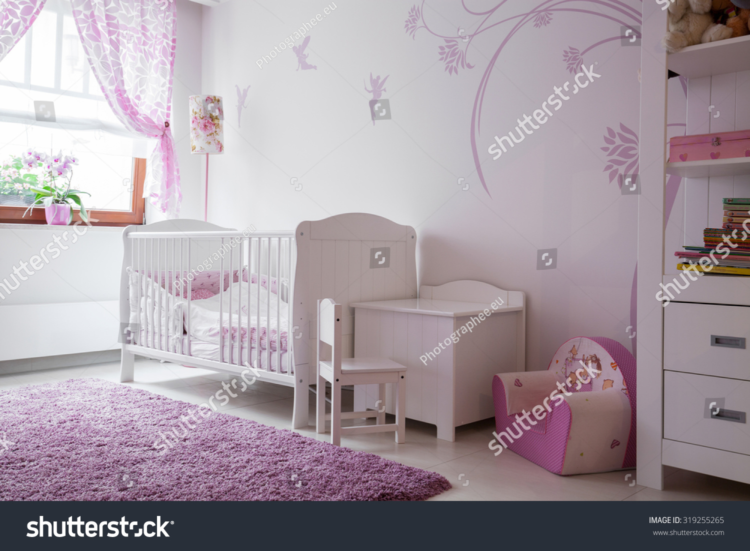 Interior baby room white furniture pink stock photo Pink room with white furniture