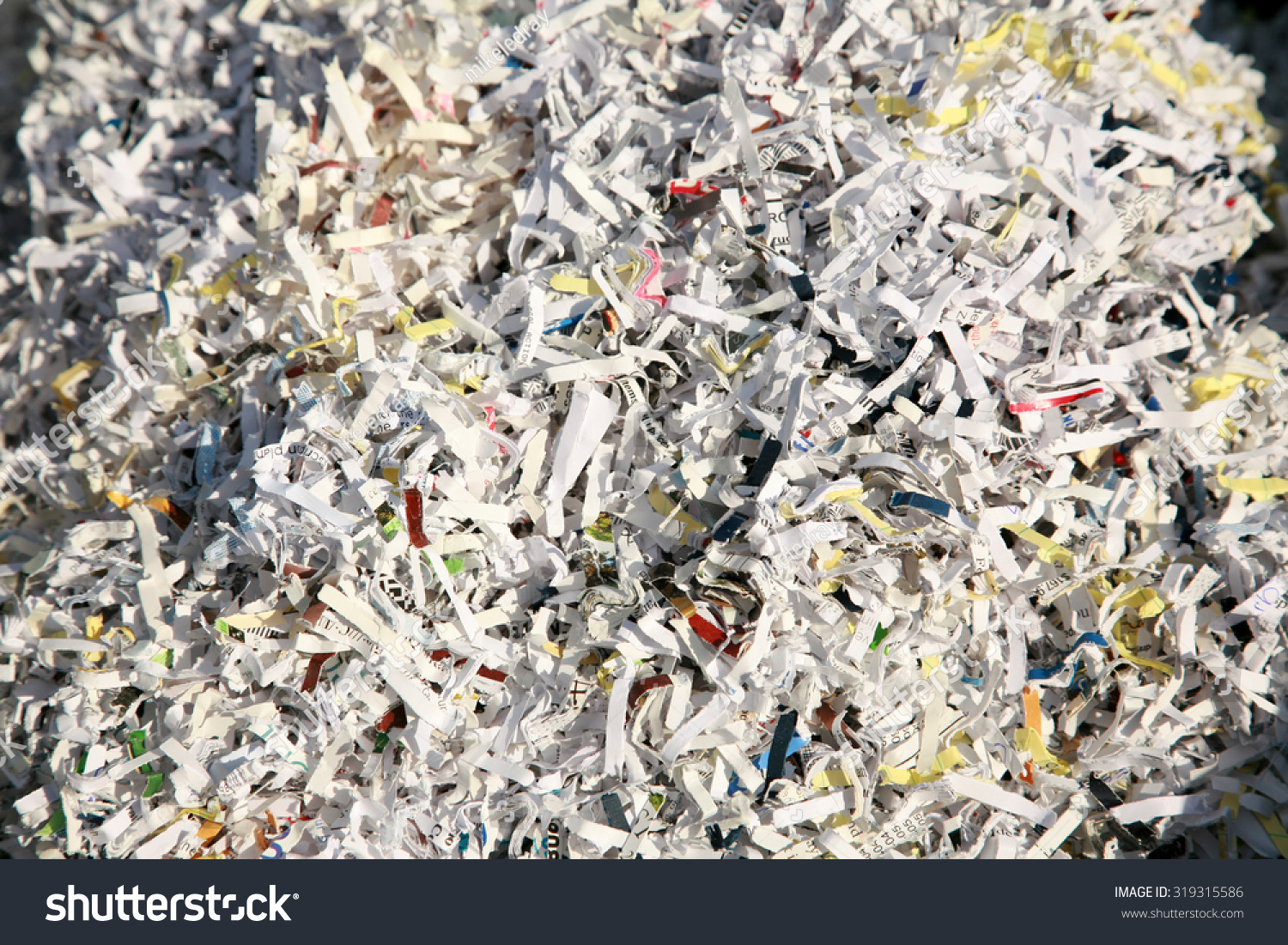 confetti shredded paper in a recycle trash can the best way to keep safe from identity fraud is. Black Bedroom Furniture Sets. Home Design Ideas