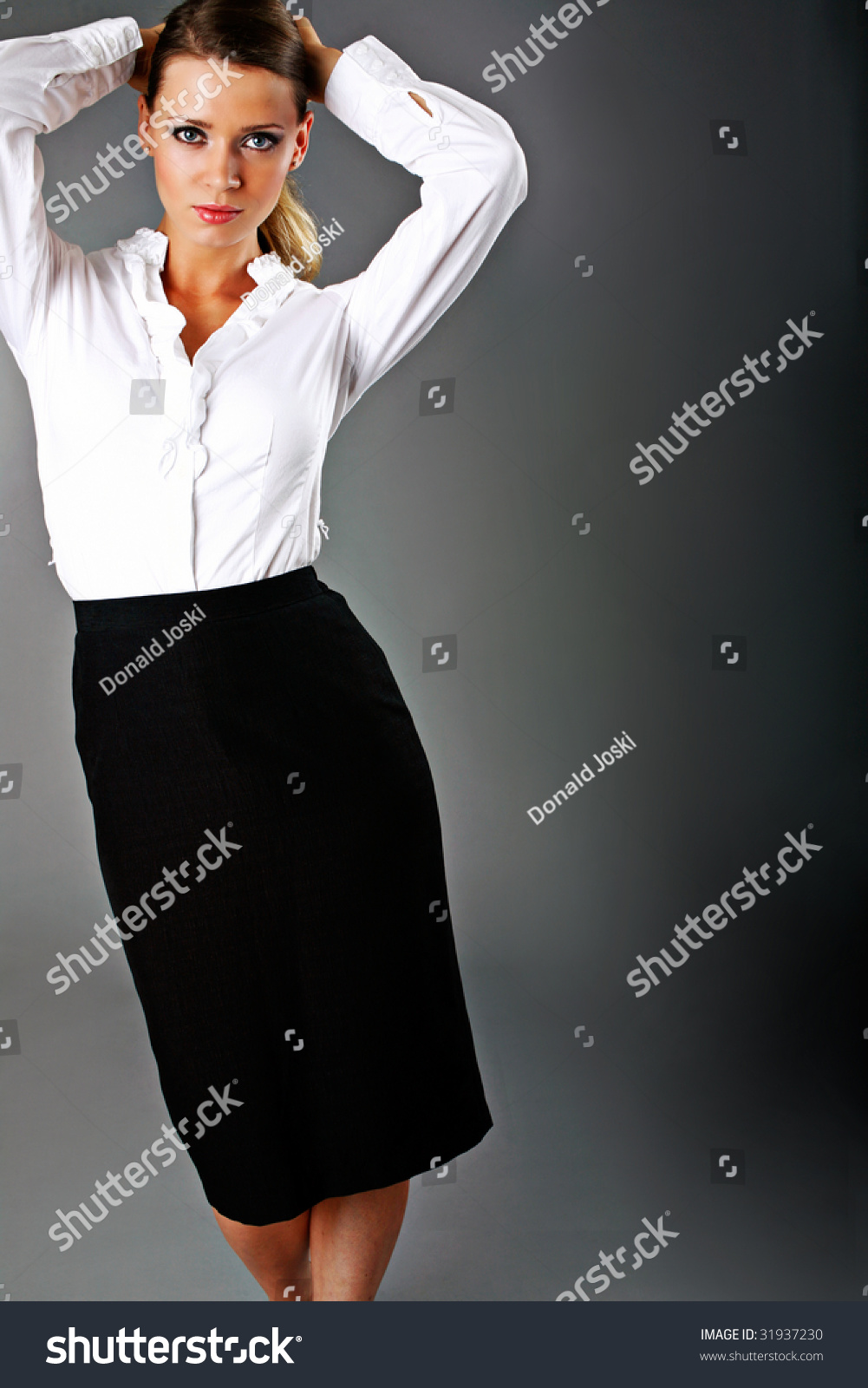 dressed for success in black skirt and white blouse stock photo save to a lightbox