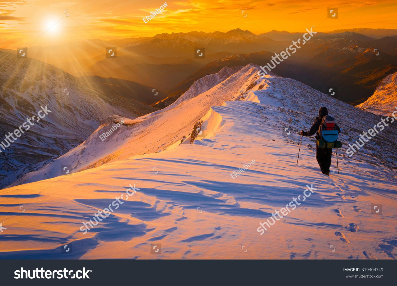 Beautiful Amazing Sunset Winter Mountains Man Stock Photo - This man hikes up the transylvanian mountains every morning to photograph sunrise