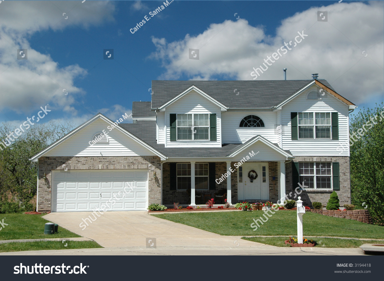 Modern middle class american home clouds stock photo for American classic homes mn
