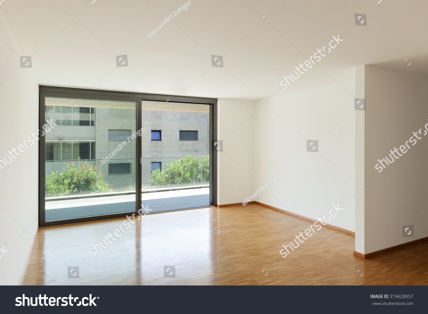 Interior Of An Apartment Empty Living Room With Balcony Parquet Floor