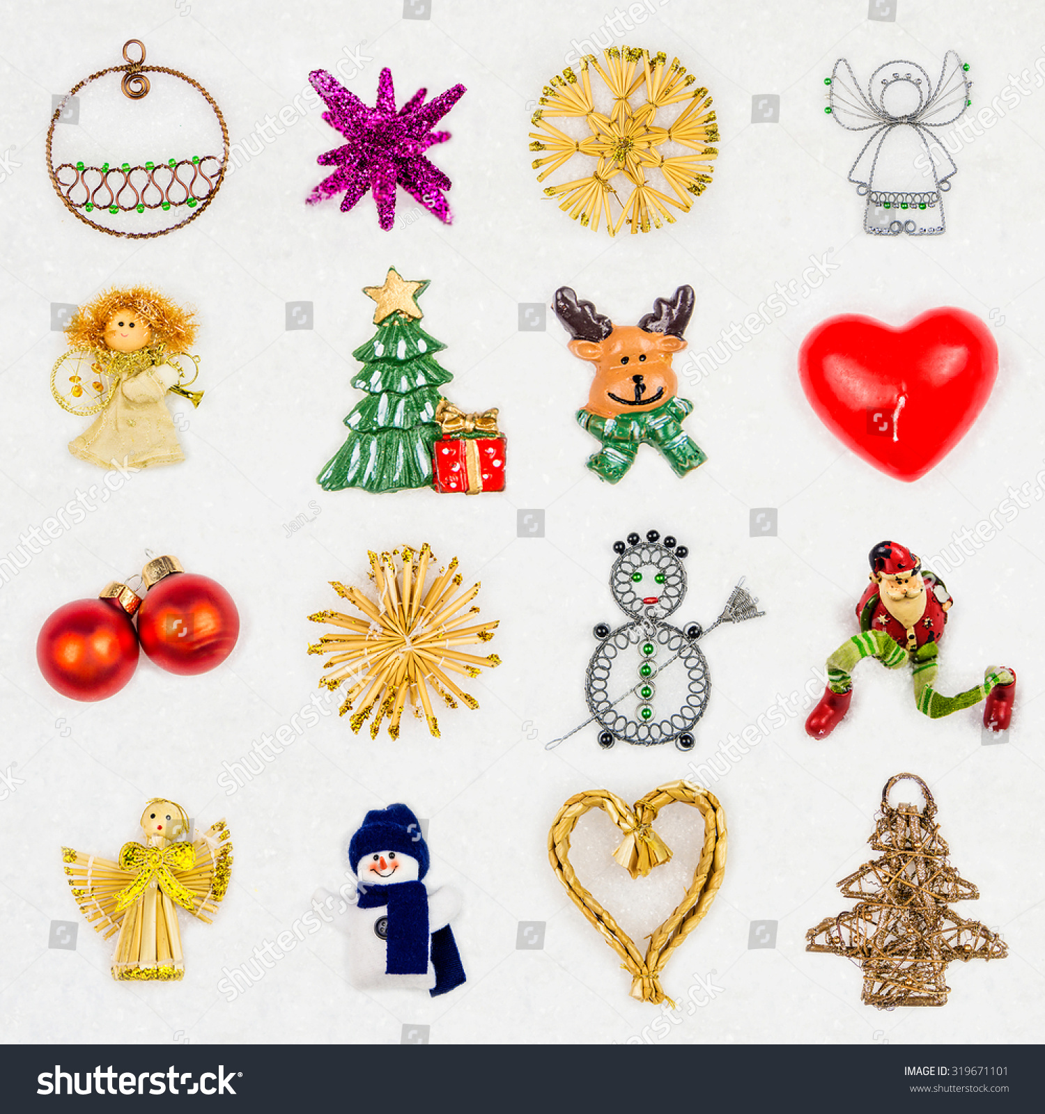 many different christmas decorations on snowy background with variation in color material and shapes - Different Christmas Decorations