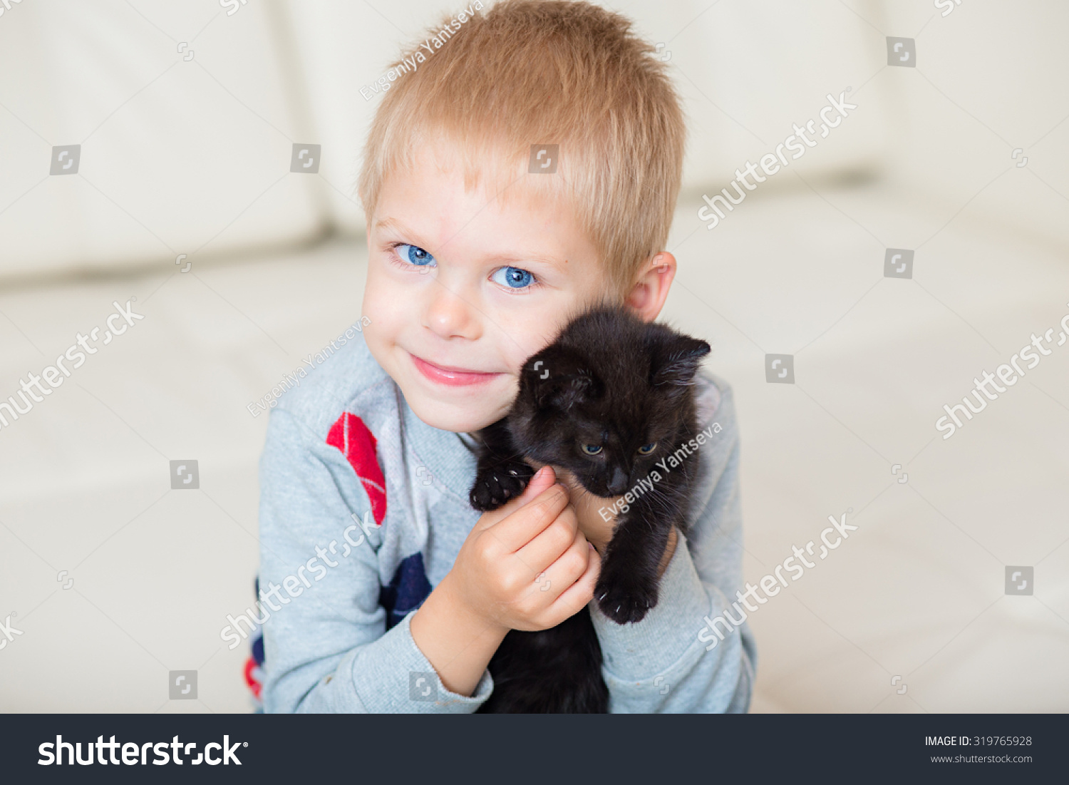 Little Blond Boy Playing Black Kitten Stock Photo