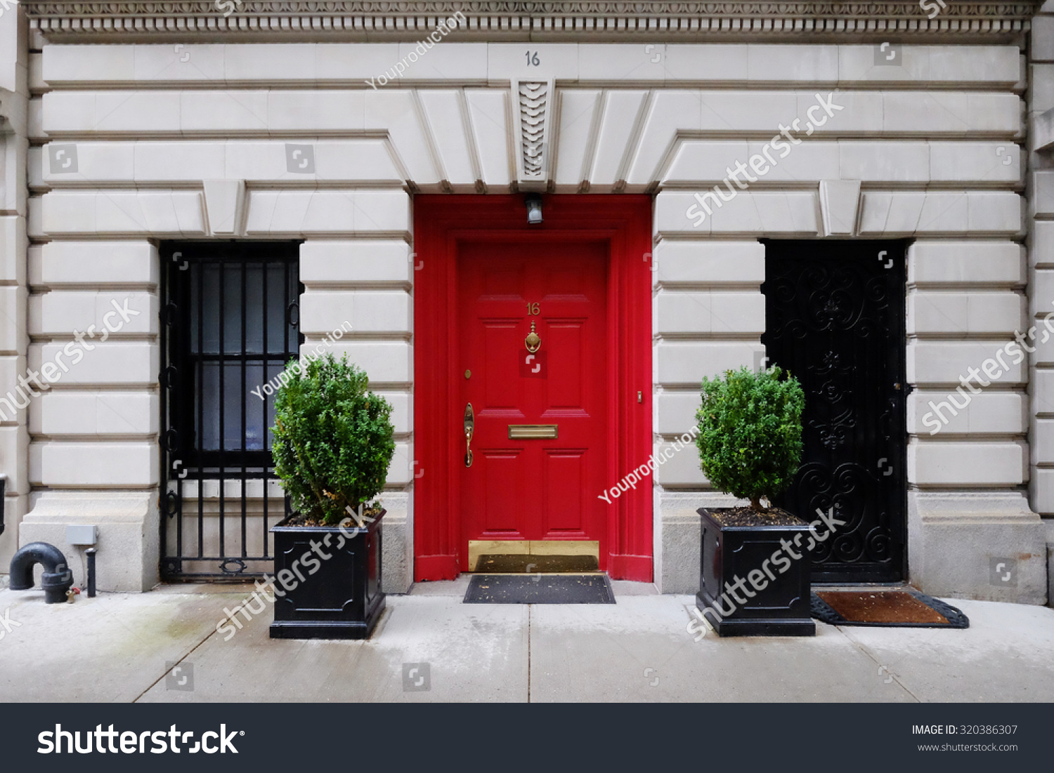 City Apartment Building Entrance beautiful building entrance red door manhattan stock photo