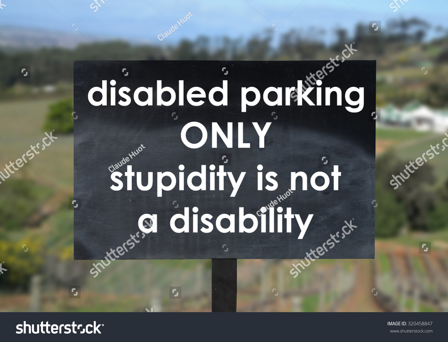 Humorous sign in a parking lot of a winery in South Africa