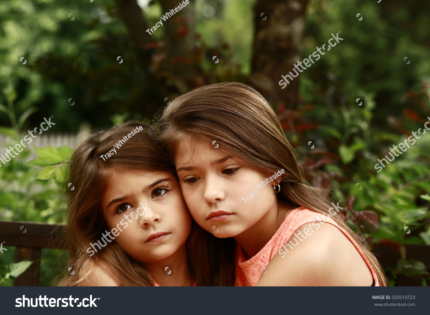 Two Beautiful Girls Heads Together Outside Stock Photo ...