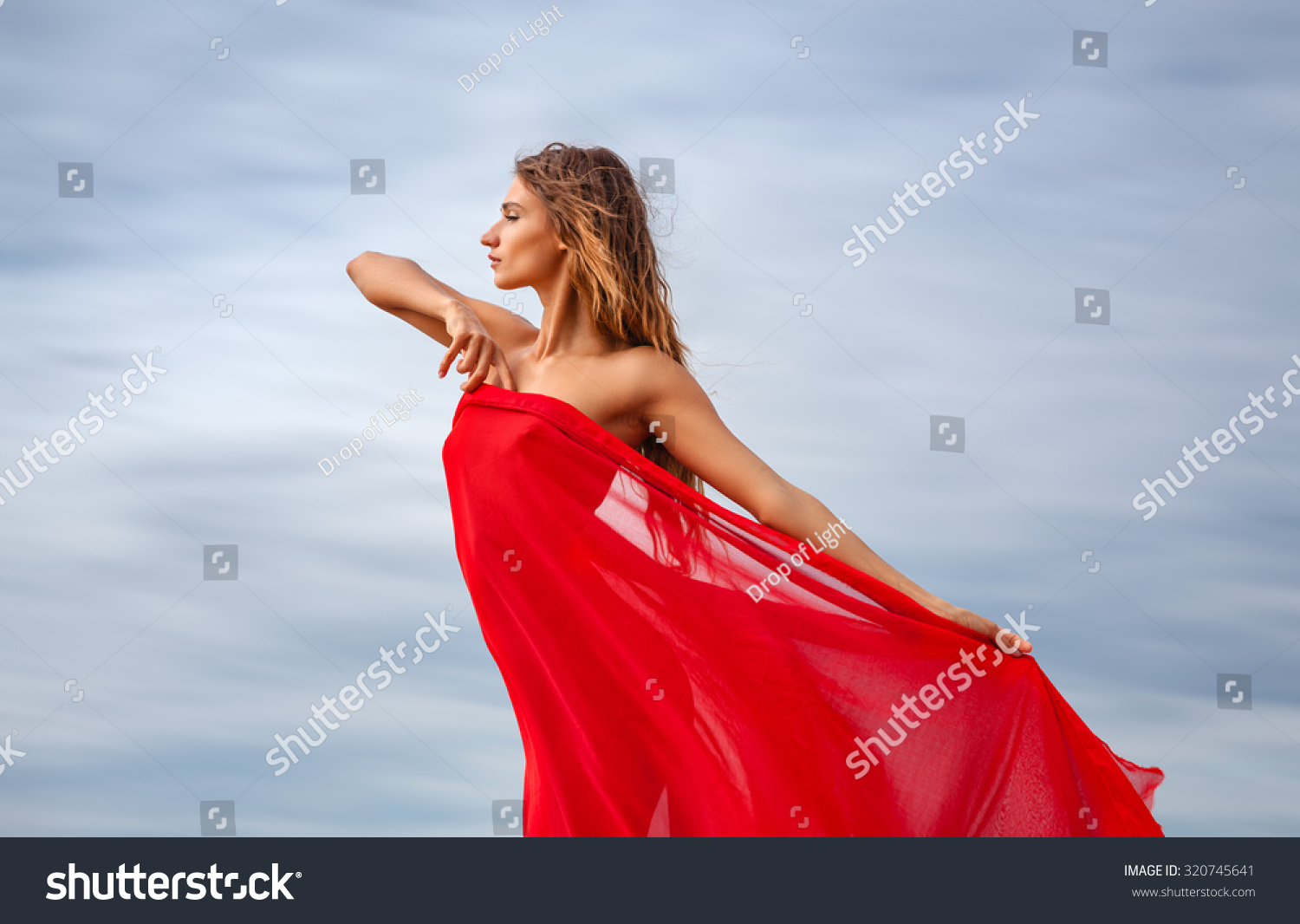 Beautiful Young Woman Red Fabric Posing Stock Photo Edit Now L 730 Cute Sexy Cloudy Water Lingerie Dress With Against Sky Background