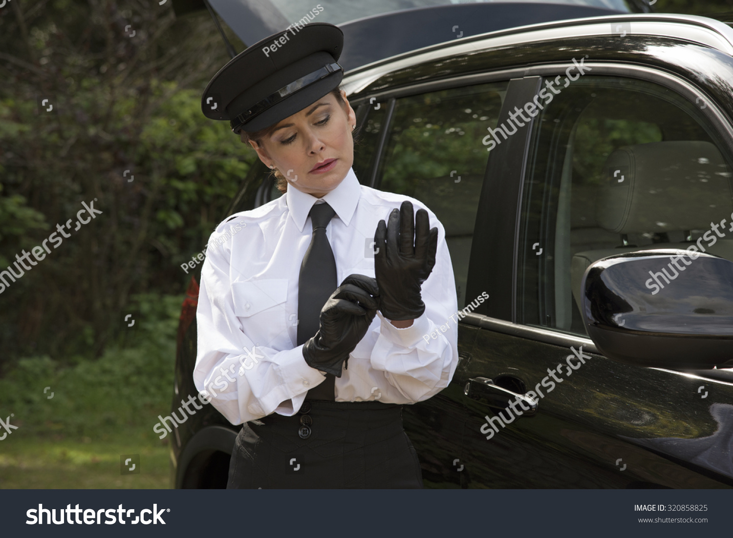 Black leather uniform gloves - Woman Chauffeur Putting On Her Uniform Black Leather Gloves