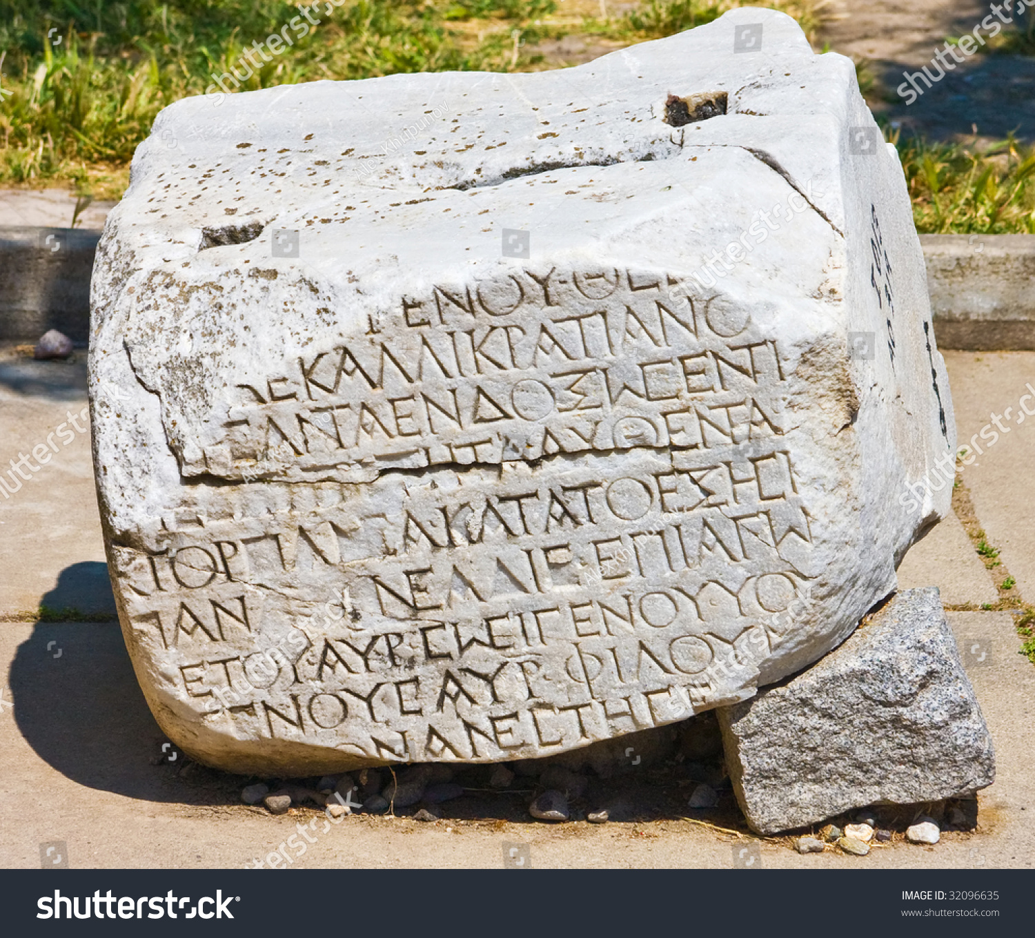 Ancient stone with carving in troy city turkey stock
