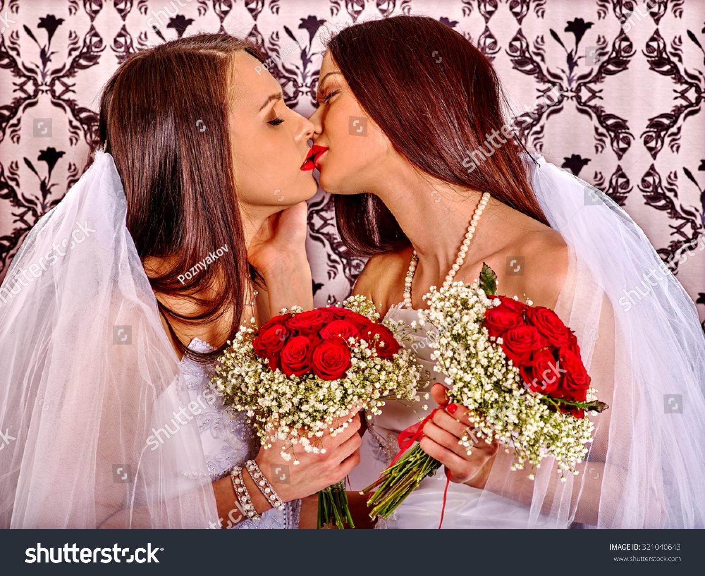 Wedding lesbians girl in bridal dress. Wallpaper in background