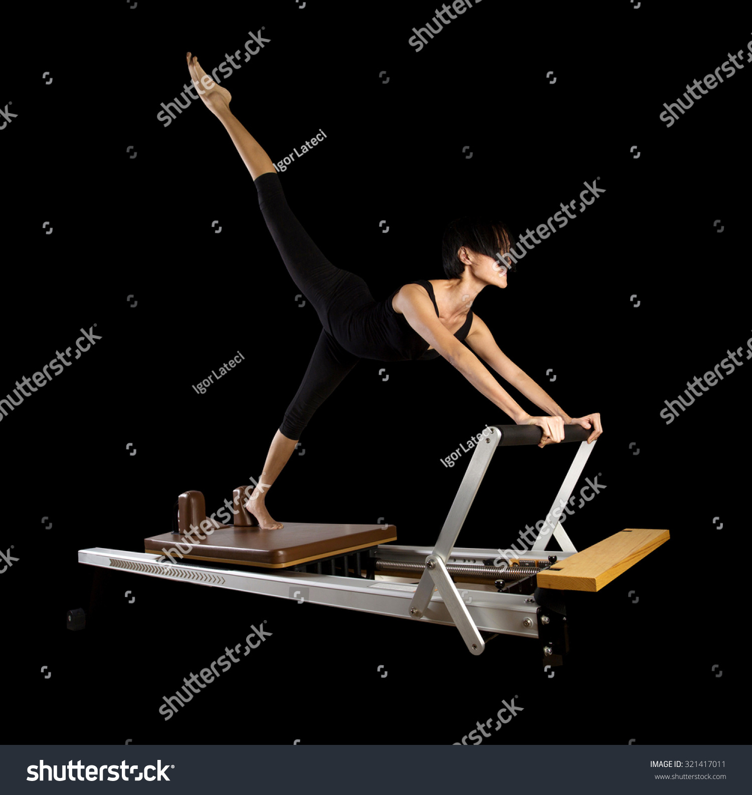 Woman Pilates Chair Exercises Fitness Stock Photo: Pilates Reformer Workout Exercises Woman Brunette At Gym