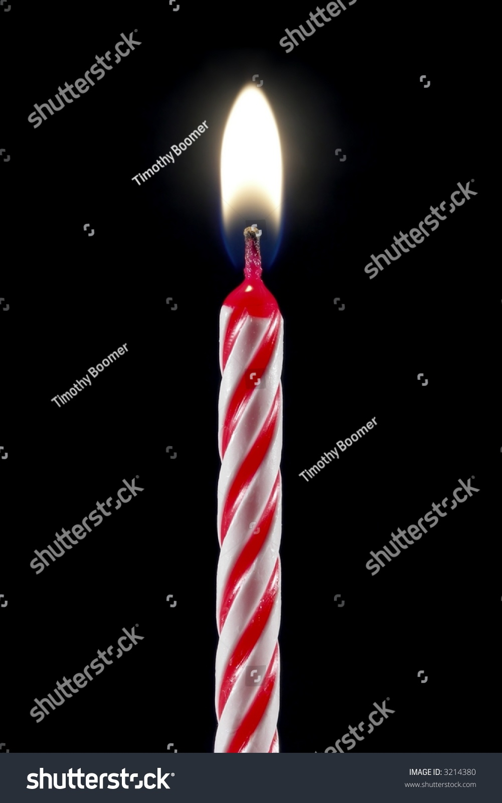 One Lit Birthday Candle Isolated Over Black Stock Photo