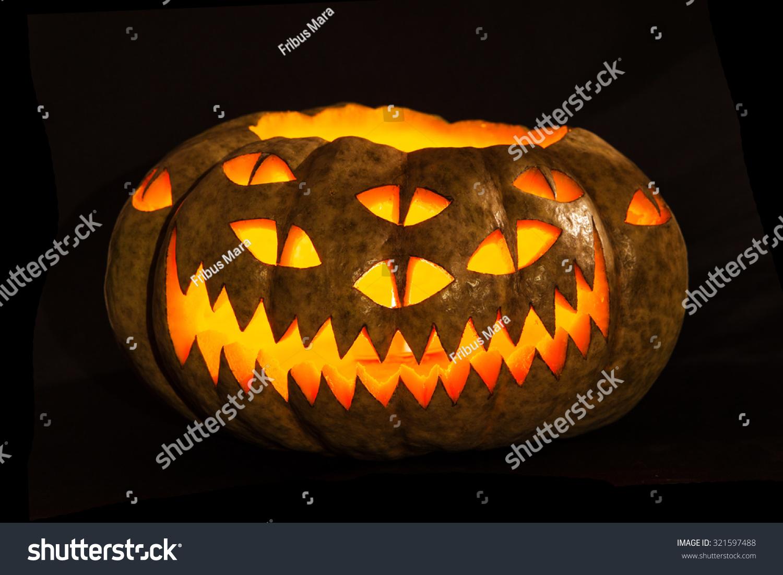 traditional glowing halloween jackolantern carved unusual stock
