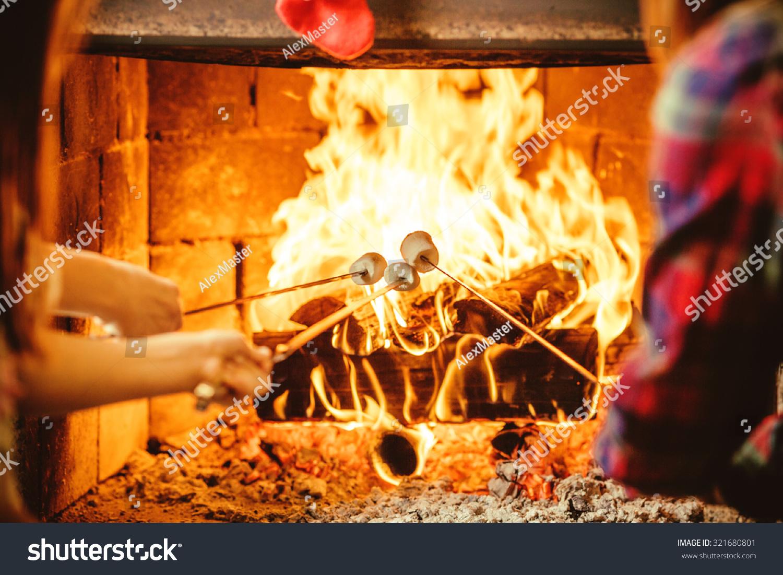 Family Roasting Marshmallows By Fire Cozy Stock Photo ...