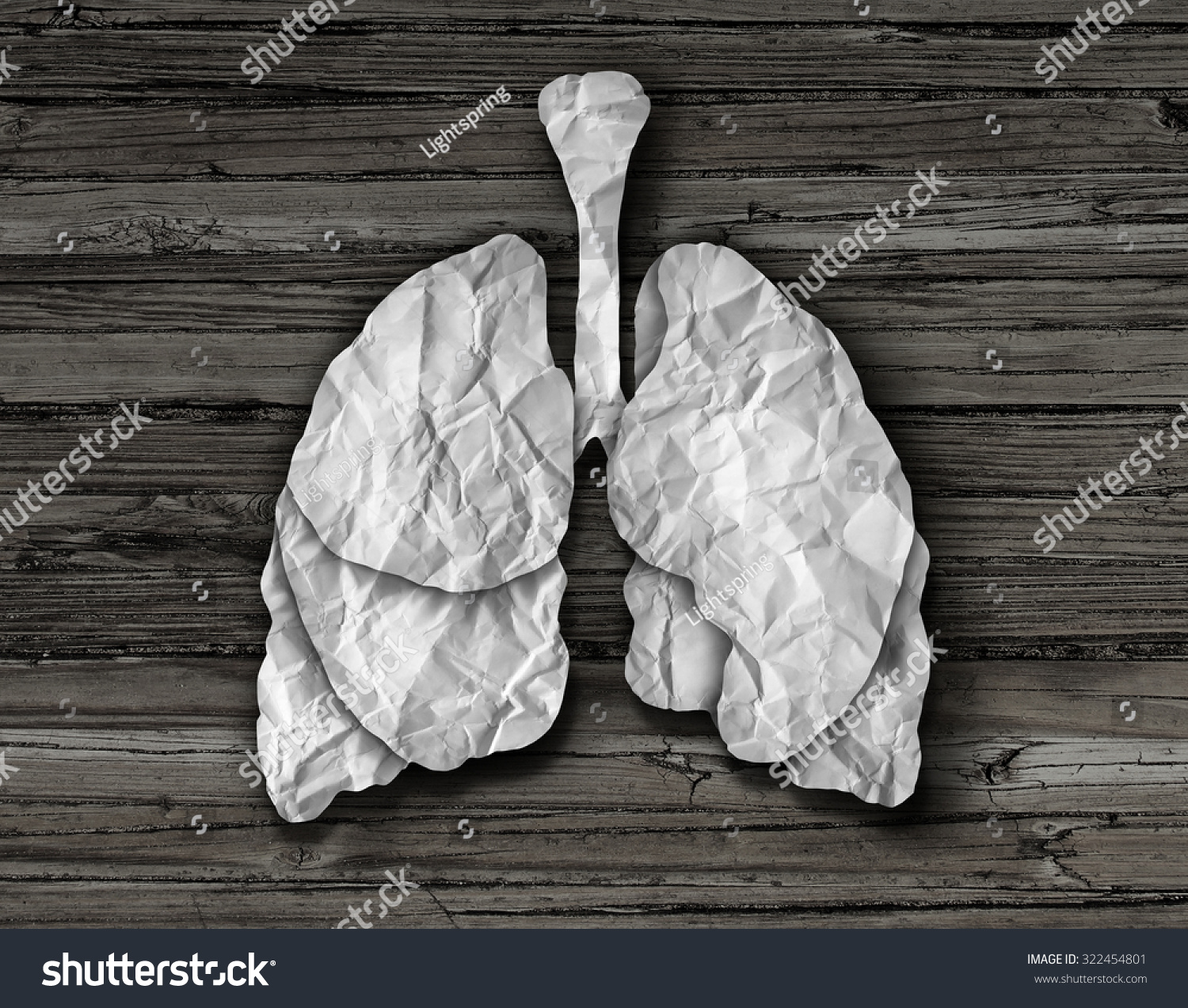 Human lung concept or healthy lungs organ made of cut crumpled white paper on an old wood background representing the medical anatomy of the respiratory system to provide oxygen to the body