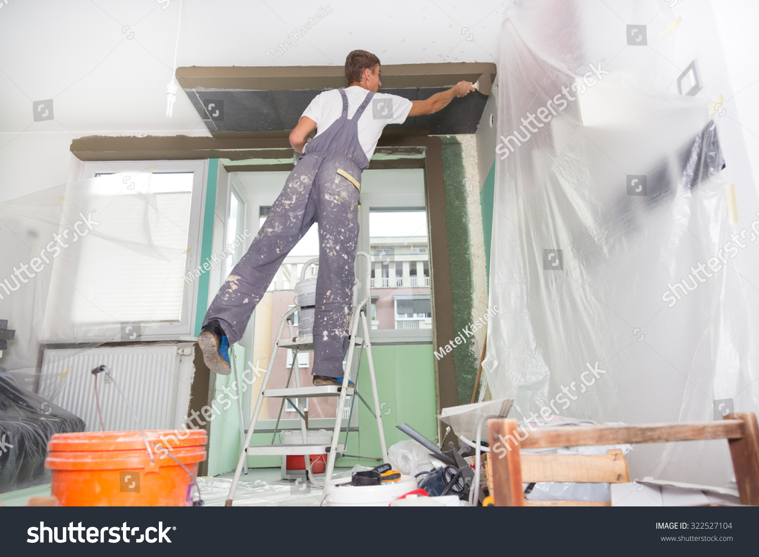 Thirty Years Old Manual Worker With Wall Plastering Tools