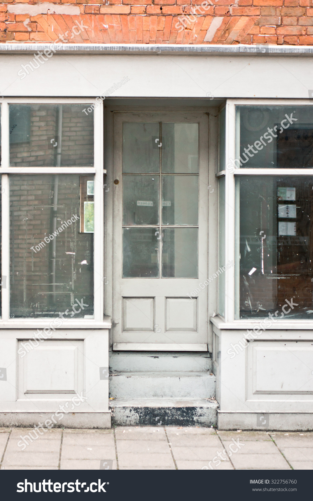 An Empty Store With Glass Windows And Door In A Uk Town Ez Canvas