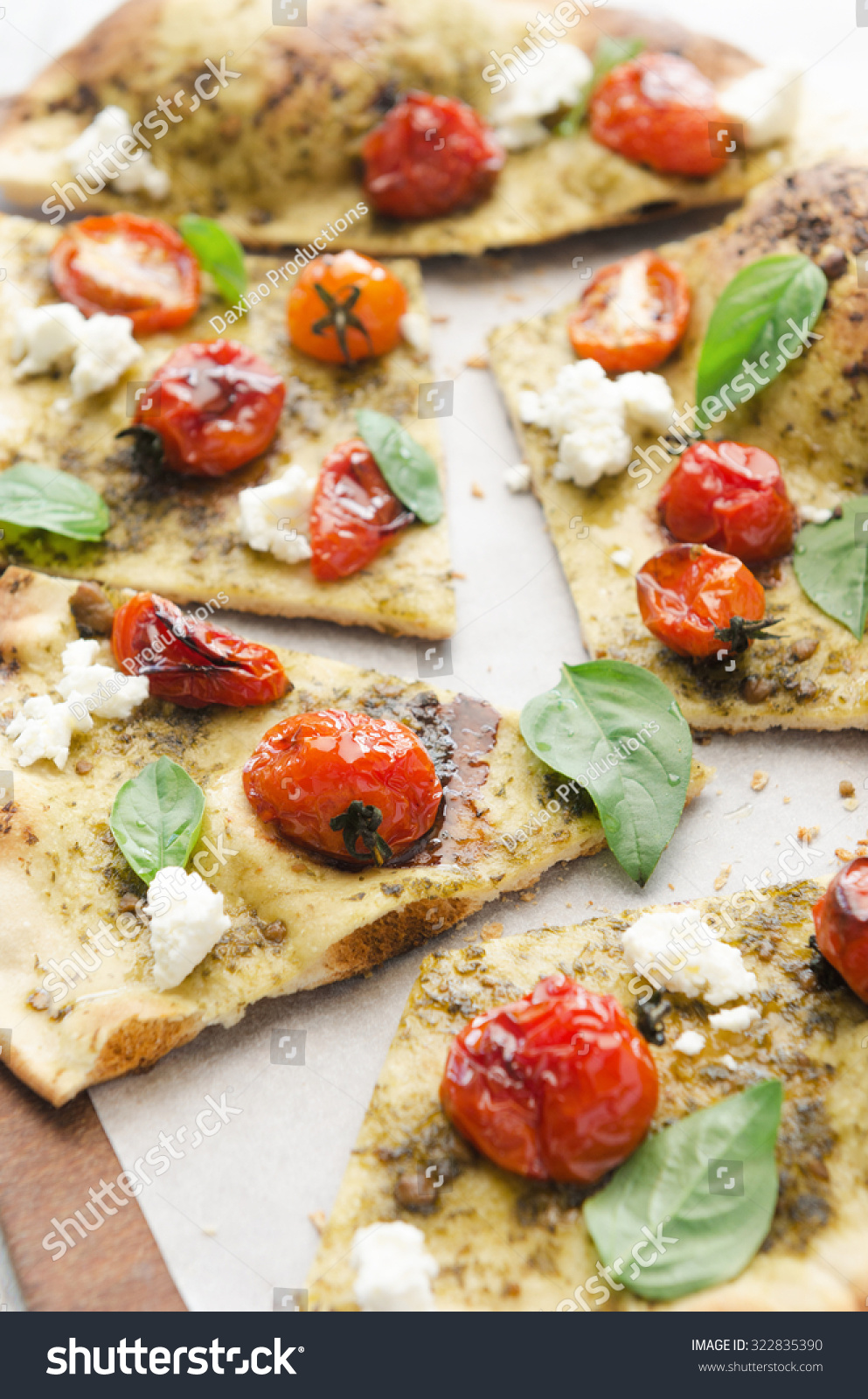 ... thin crust pizza with roasted tomatoes, fresh basil and feta cheese