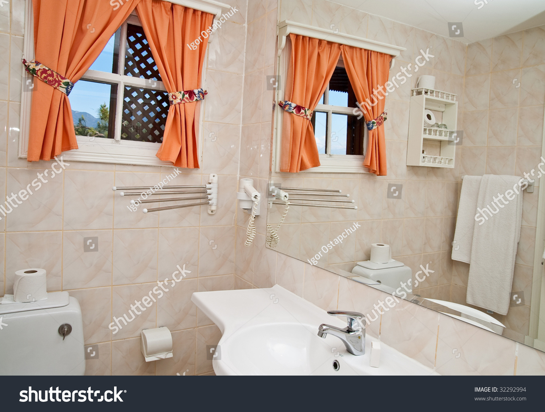 Mirror on wall bathroom stock photo 32292994 shutterstock mirror on a wall of bathroom amipublicfo Gallery
