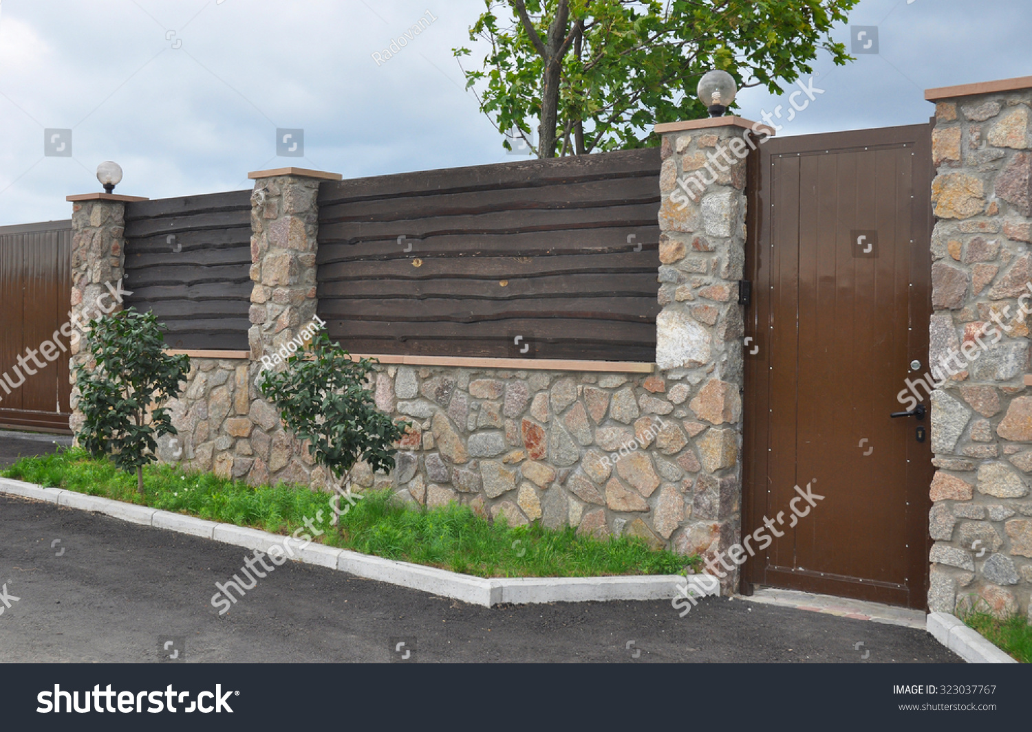 Stone metal fence door modern style stock photo 323037767 for Decorative wall fence