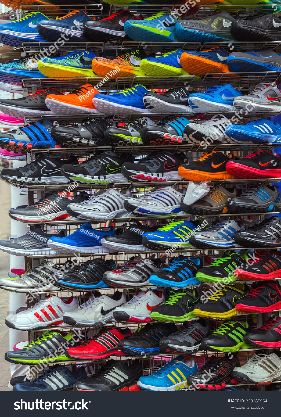Adidas Shoes In Shoe Store Display and of Nike sport shoes. New unbranded  running shoe 6871a79fb
