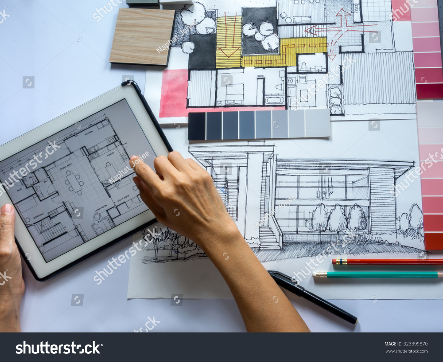 Top view of architects interior designers hands working on table with tablet and illustration for Best tablet for interior designers