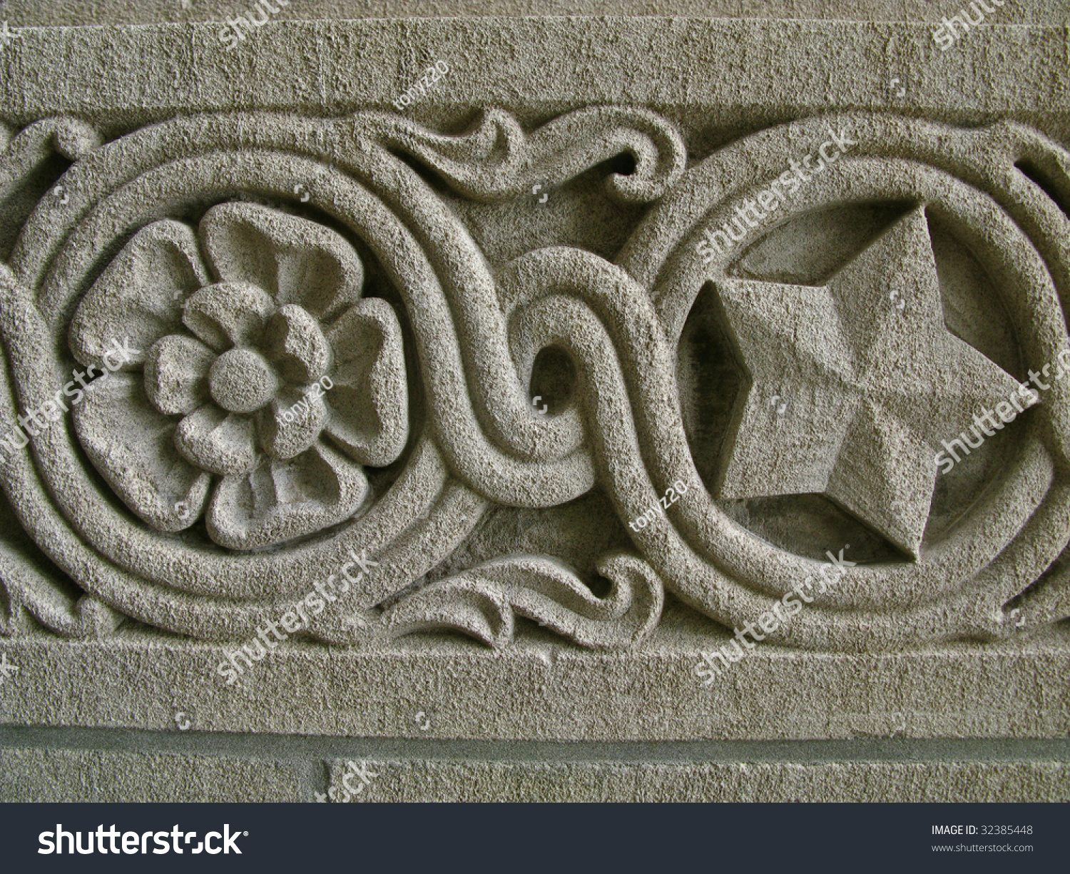 Stone carving on side old building stock photo
