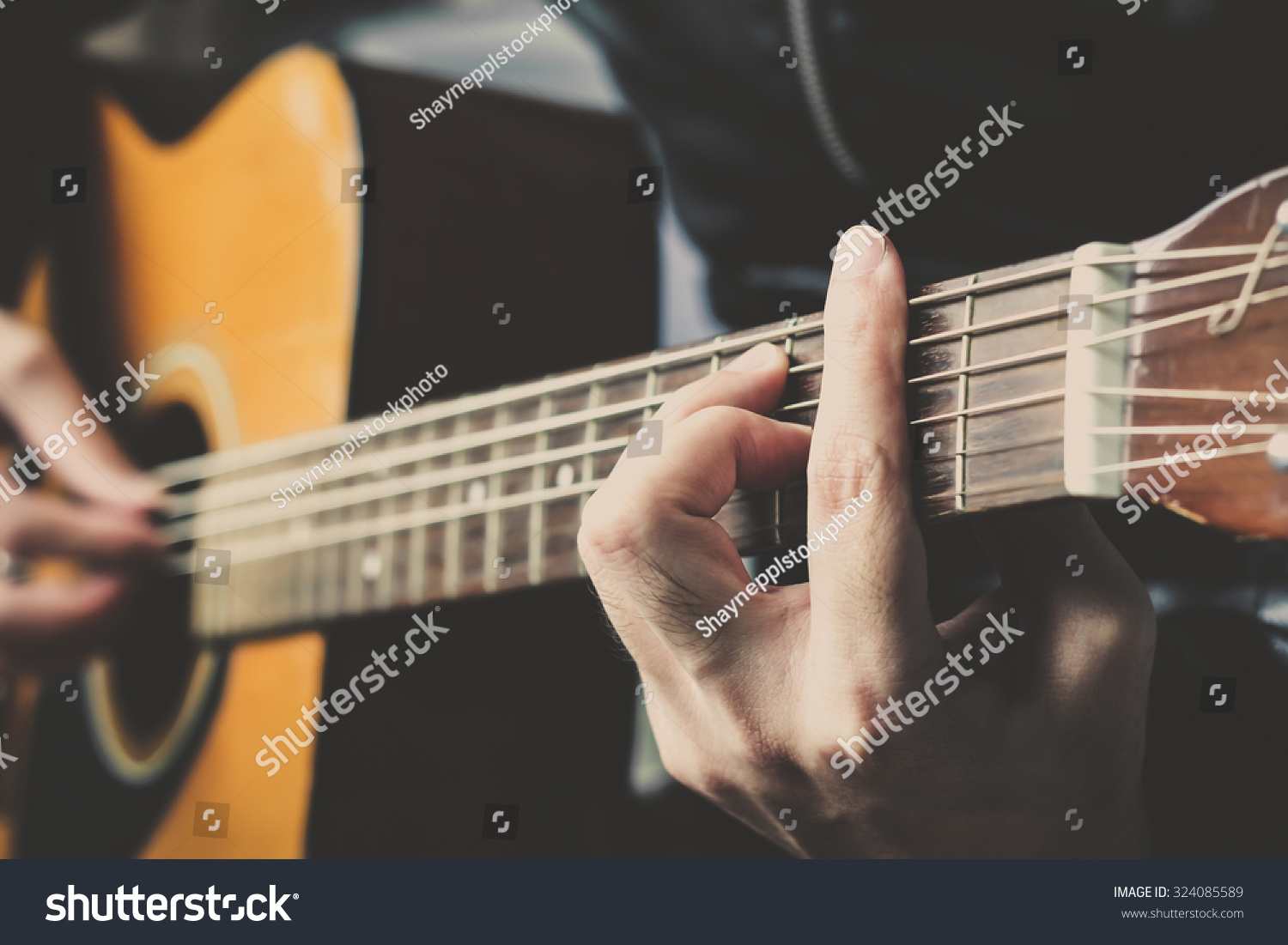 Closeup Hand Playing On Acoustic Guitar Stock Photo Edit Now