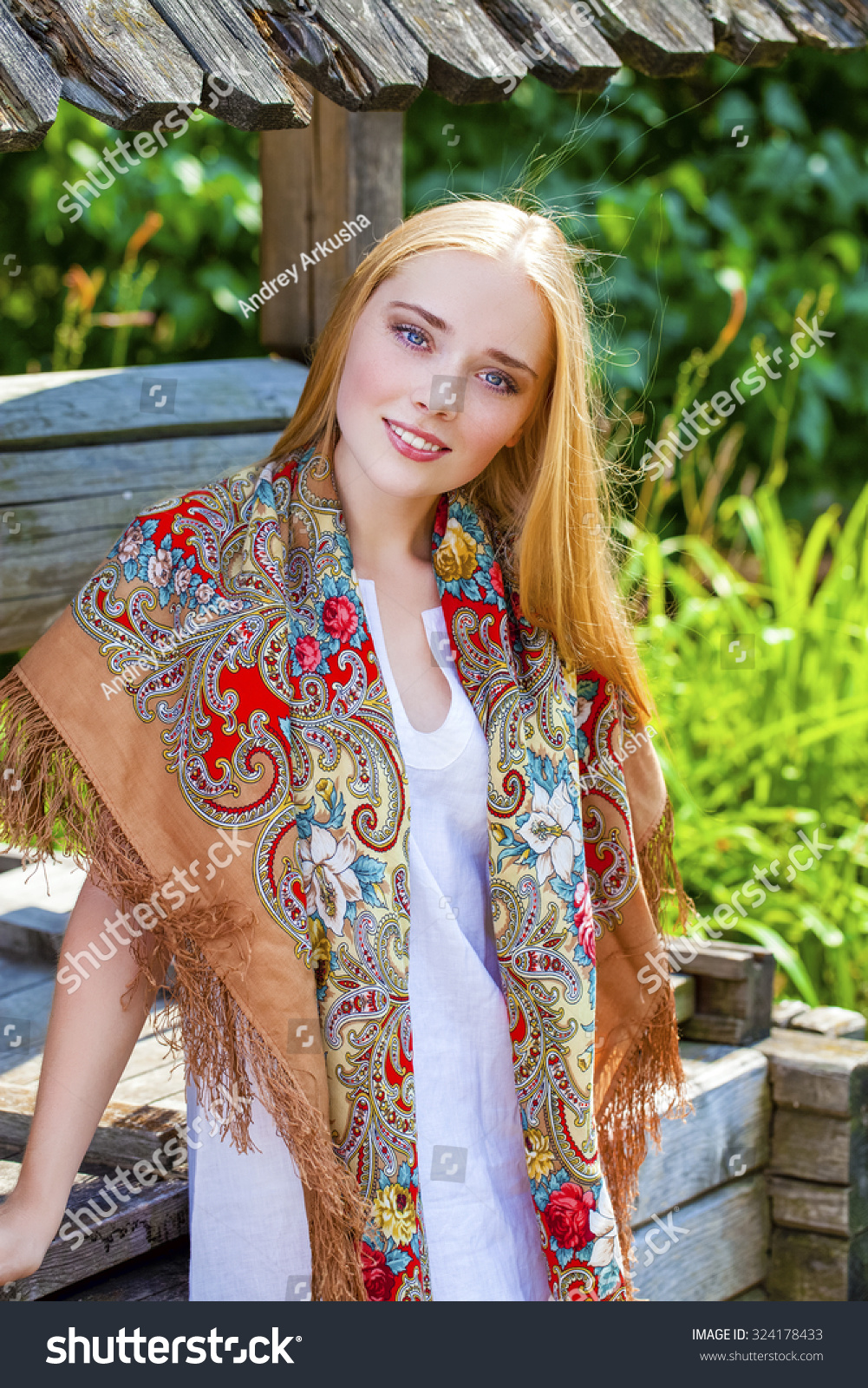 https://image.shutterstock.com/z/stock-photo-russian-beauty-woman-in-the-national-patterned-scarf-324178433.jpg