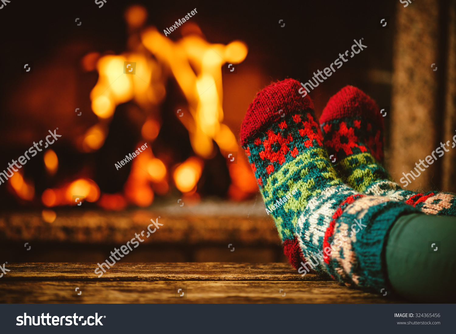 feet woollen socks by fireplace woman stock photo 324365456