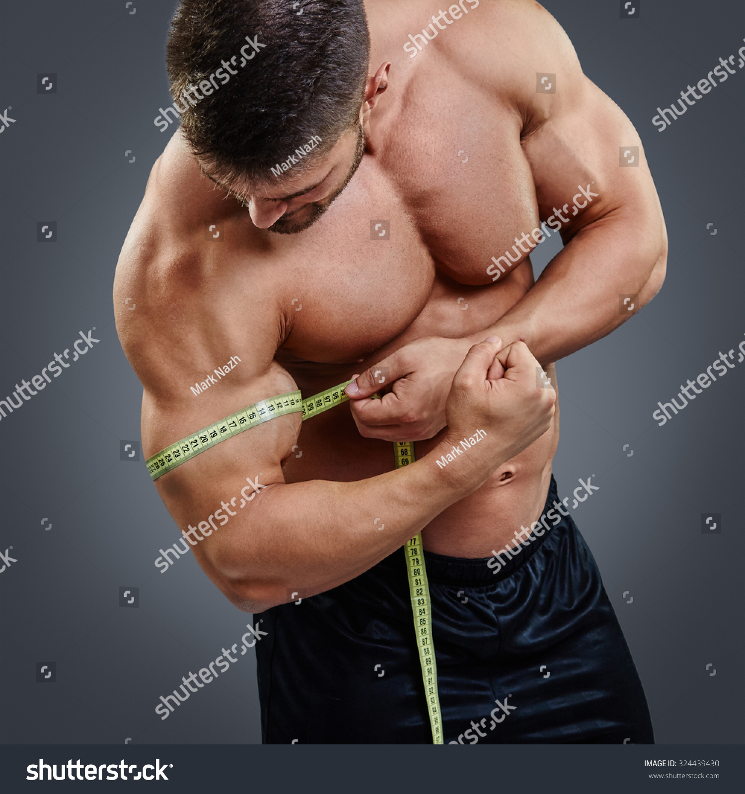 closeup muscular bodybuilder measuring biceps tape stock photo 324439430 shutterstock. Black Bedroom Furniture Sets. Home Design Ideas