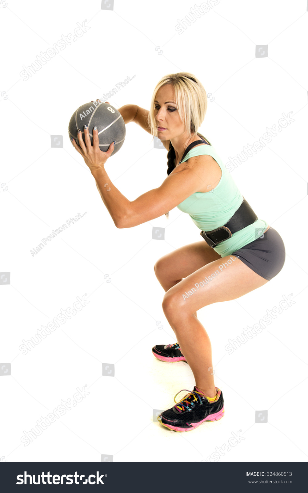 Woman Doing Squat Weighted Ball Stock Photo (Edit Now) 324860513
